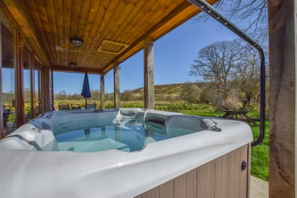 The hot tub and the great view from it at Llanddewi Retreat