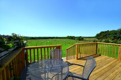 Rear decked area of the property, with views of the countryside