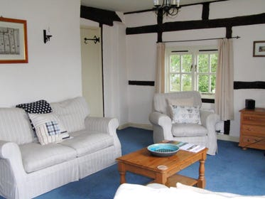 The sitting room is comfortable and attractively furnished