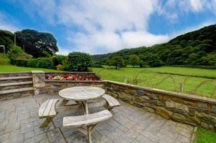 Fantastic views overlooking the river Gwaun from the garden, with picnic table and chairs