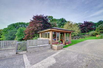 The attractive garden includes a summer house, with panoramic views over the Severn valley and hills