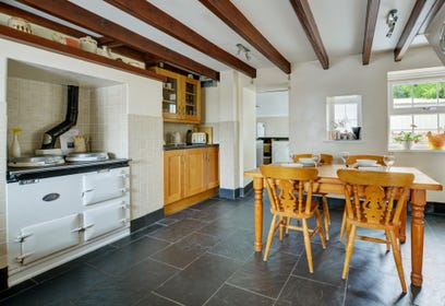 Open place kitchen/dining area with feature Aga