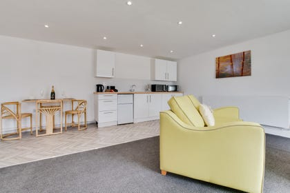 Self catering accommodation with open plan lounge, kitchen and dining areas.