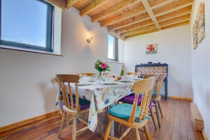 Rural self catering property with light and airy dining room.