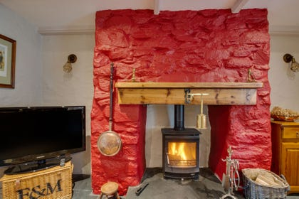 The wood burner in lounge  / dining room