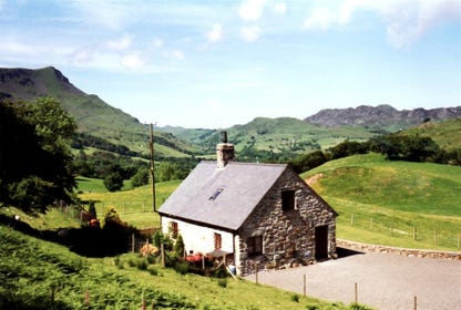 This lovely detached cottage stands in a stunning secluded location on the slopes of Cadair Idris