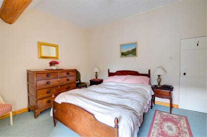 Antique bed and chest of drawers in the main bedroom