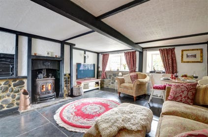 Cosy sitting room with wood burner and large TV
