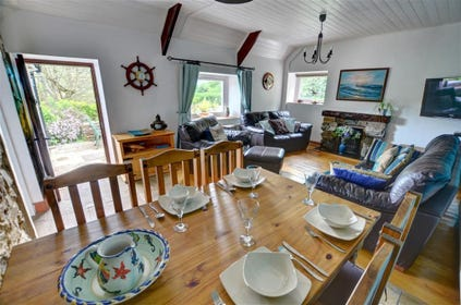The lounge/dining room has a dining table and 6 chairs, open fire and TV