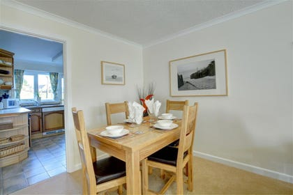 Dining area with space for 4 people. Leads to the kitchen