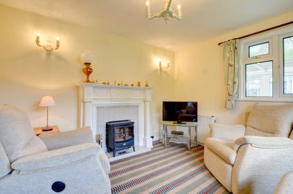 Cosy sitting Room with electric stove or open fire