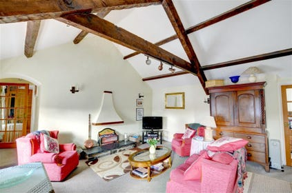The beautifully spacious sitting room is open-plan to the kitchen and dining area