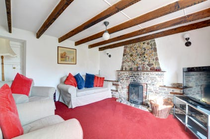 The sitting room has an open fire, with its own digital TV & Blu-ray DVD player