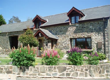 Friendly Cottage is a detached stone barn converted into a lovely cottage in the quiet and historic part of the village of Llanarth