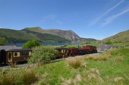 The Welsh Highland Railway runs along the lake (Llyn Cwellyn) and behind the cottage