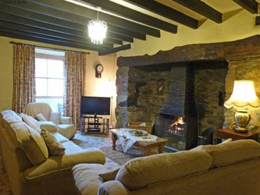 Large sitting room with old beams, inglenook fireplace, T.V. and Sky