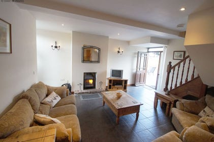 Cosy lounge with woodburner at this luxury self catering, Chepstow