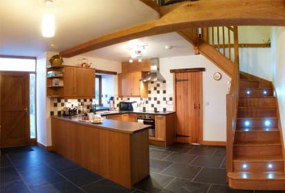 Light oak modern fitted kitchen includes a dishwasher & microwave
