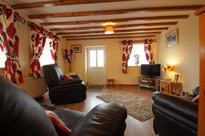 Lounge with leather 3 piece suite and great views over Snowdonia