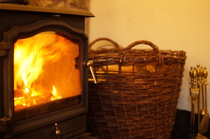 Cosy lounge with oak beamed inglenook and welcoming log burner