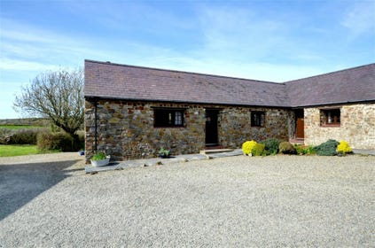 Shippon is an end cottage, set at right-angles to the other two, garden to the rear